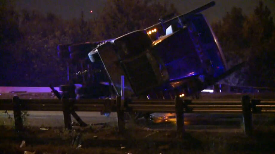 An 18-wheeler flipped over on the North Loop westbound near I-45 early Tuesday morning. No injuries were reported. Photo: Metro Video