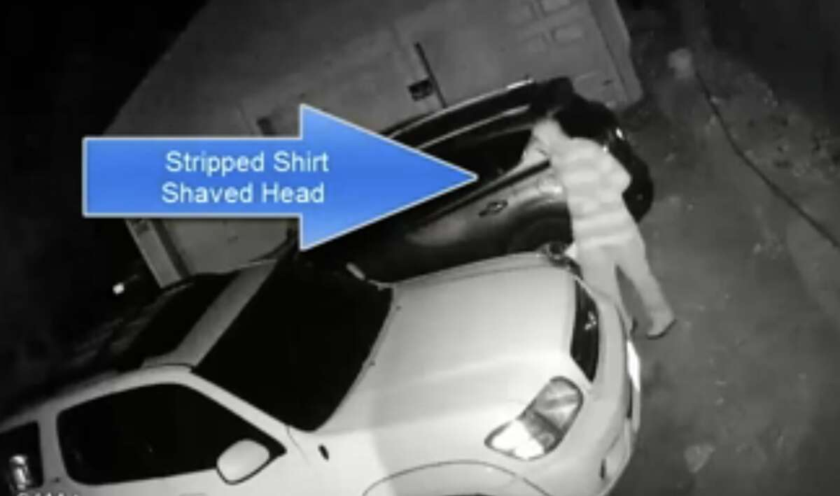 Police are trying to identify a man caught on video breaking into vehicles on Anderson Street in Stamford on Oct. 15, 2015.