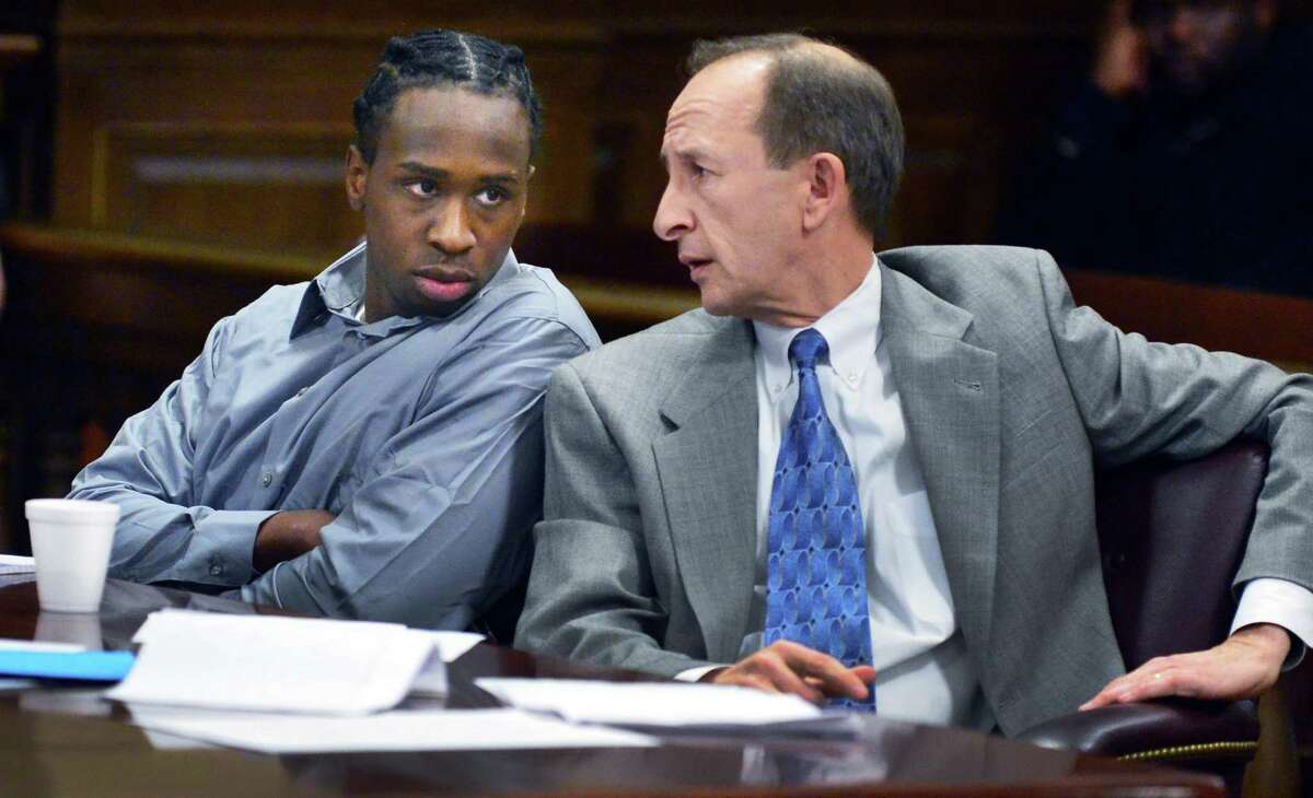 Defendant Quintril Clark, 23, of Troy, left, and defense attorney Frederick Rench during opening arguments in the murder case of victim Sha-Kim Miller Tuesday Dec. 3, 2013, at the Rensselaer County Courthouse in Troy, NY. (John Carl D'Annibale / Times Union)