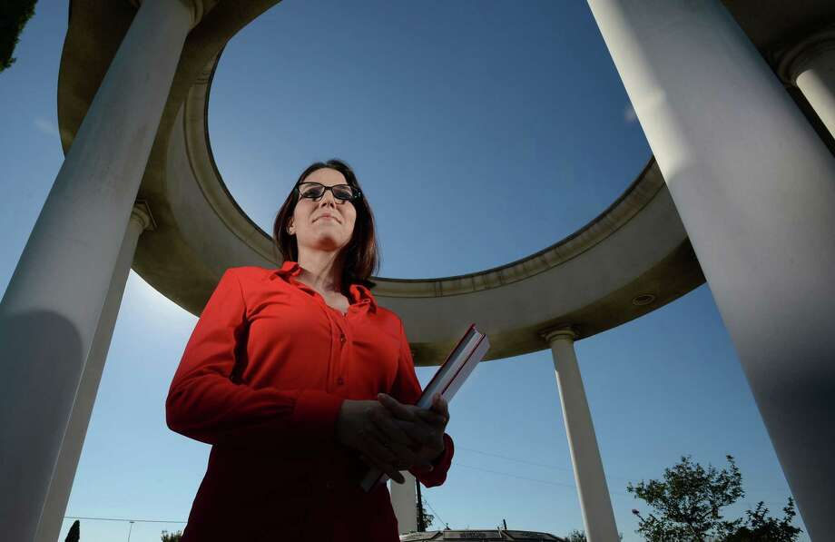 Cassandre Durso holds her thesis about Italian Immigration into Southeast Texas at the Italian monument in Beaumont Monday.  