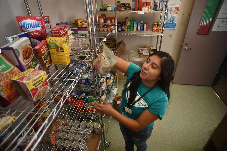 Vivian Duran, 23, of Houston and a Chemical Engineering major at Lone Star College - Montgomery who plans to finish her degree at Lamar University, volunteers at the school's food pantry between classes on Oct. 16, 2015. The food pantry is the system's first and is an official partner agency with the Montgomery County Food Bank. (Photo by Jerry Baker/Freelance)4 Photo: Jerry Baker, Freelance