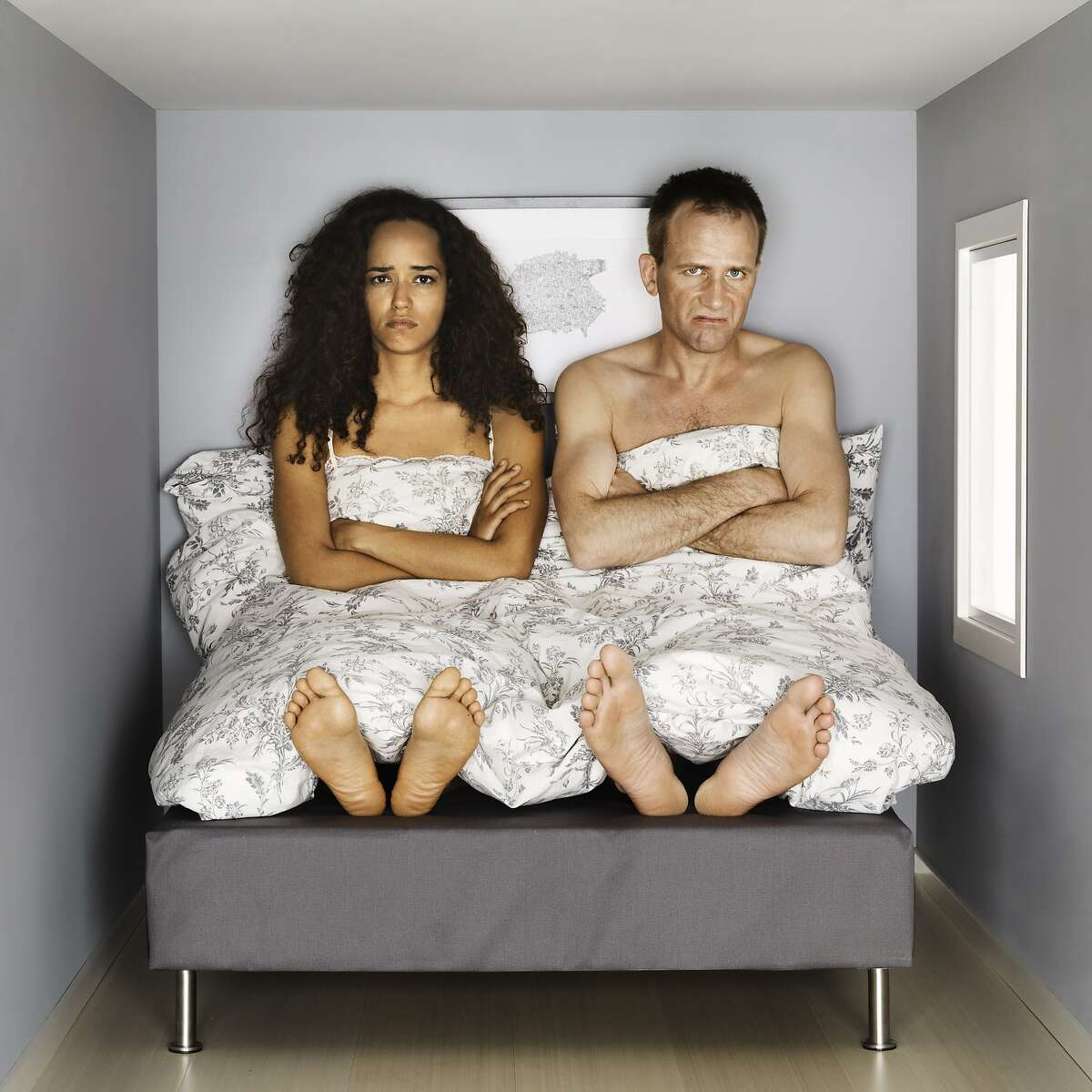 A couple doesn't sleep in the same bed.
