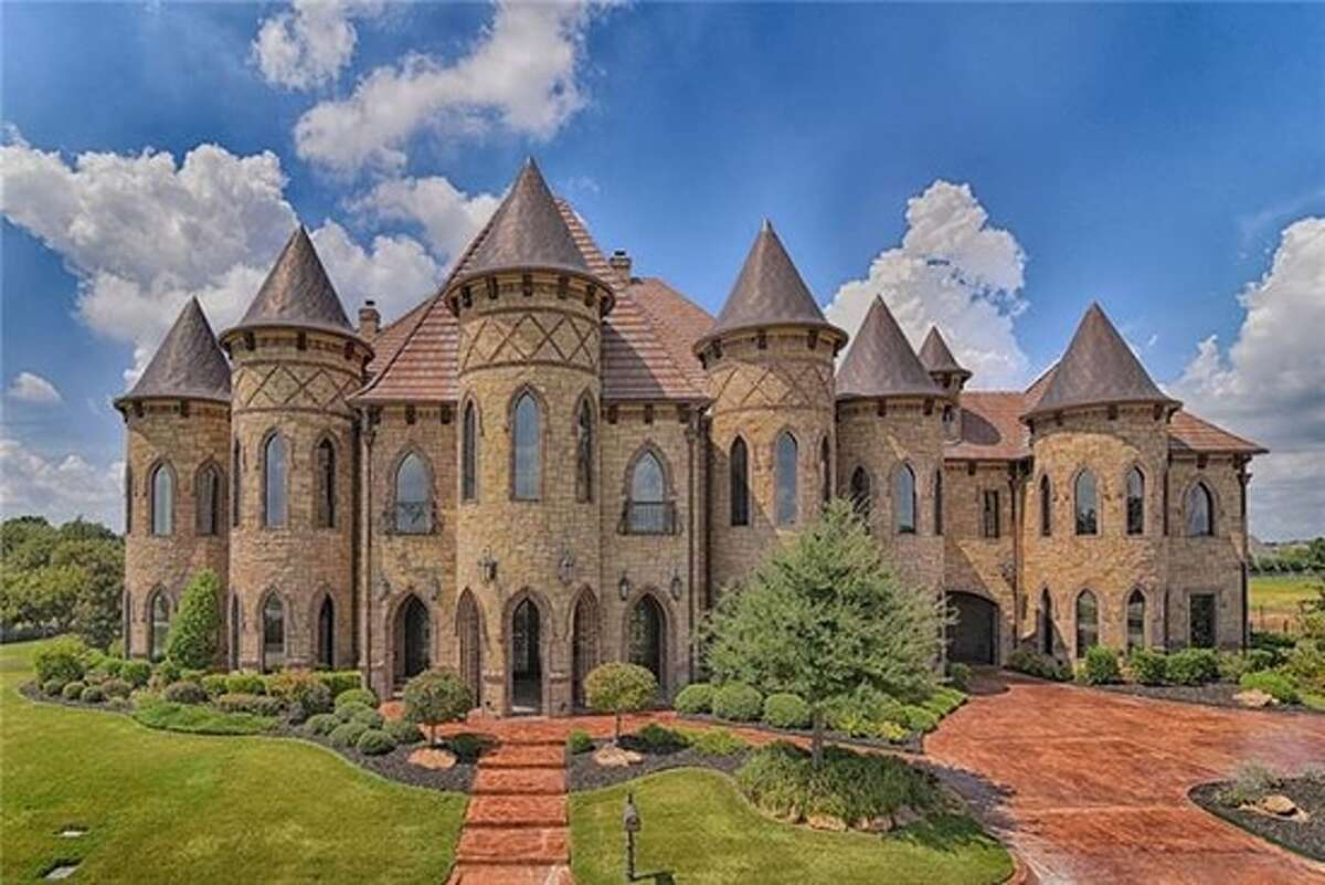 This majestic home in Southlake, Texas is going to auction. The castle-like home includes eight bedrooms, 10 bathrooms, a theater, a game room, guest quarters and a 12-car garage, according to Trulia. A pool and outdoor kitchen are outdoors.