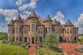 This majestic home in Southlake, Texas, has hit the market for $4.9 million. The castle-like home This majestic home in Southlake, Texas is going to auction. The castle-like home includes eight bedrooms, 10 bathrooms, a theater, a game room, guest quarters and a 12-car garage, according to Trulia. It also has a pool and outdoor kitchen.