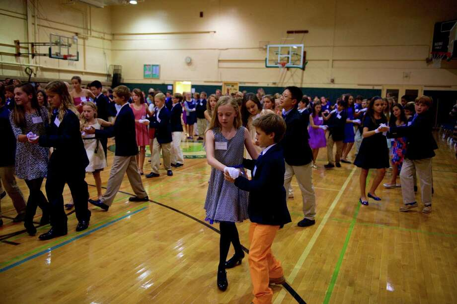 Eastern Middle School sixth-graders are learning ballroom dancing this fall. Photo: Contributed Photo
