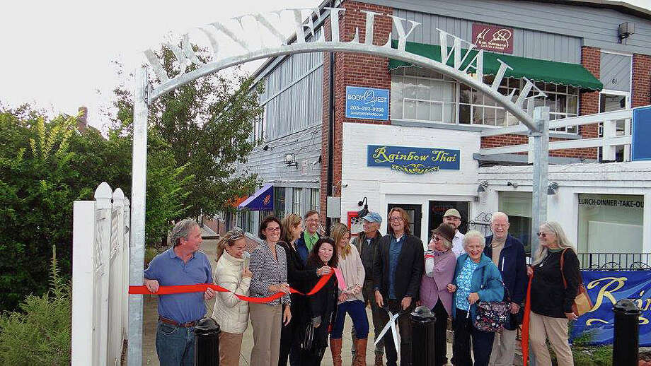 """Members of the Donnelly family, and town officials, gathered Monday to mark the new sign designating the walkway between Sanford Street and Unquowa Road """"Donnelly Walk."""" Kim and Tim Donnelly, who owned a downtown jewelry store, were both killed in a brutal robbery. Photo: Contributed Photo /Fairfield Citizen /  Fairfield Citizen contributed"""