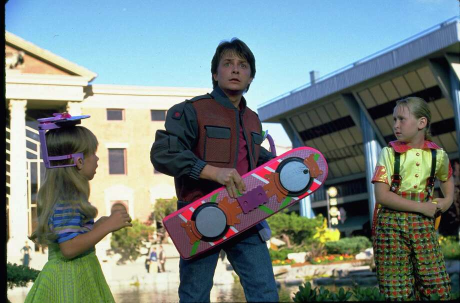 """Marty McFly (Michael J. Fox) in holding a hoverboard in """"Back to the Future Part II."""" The 1989 film featured what the future would look like in 2015. Image courtesy Universal Pictures Home Entertainment. Photo: Universal Pictures Home Entertai / Universal Pictures Home Entertai"""
