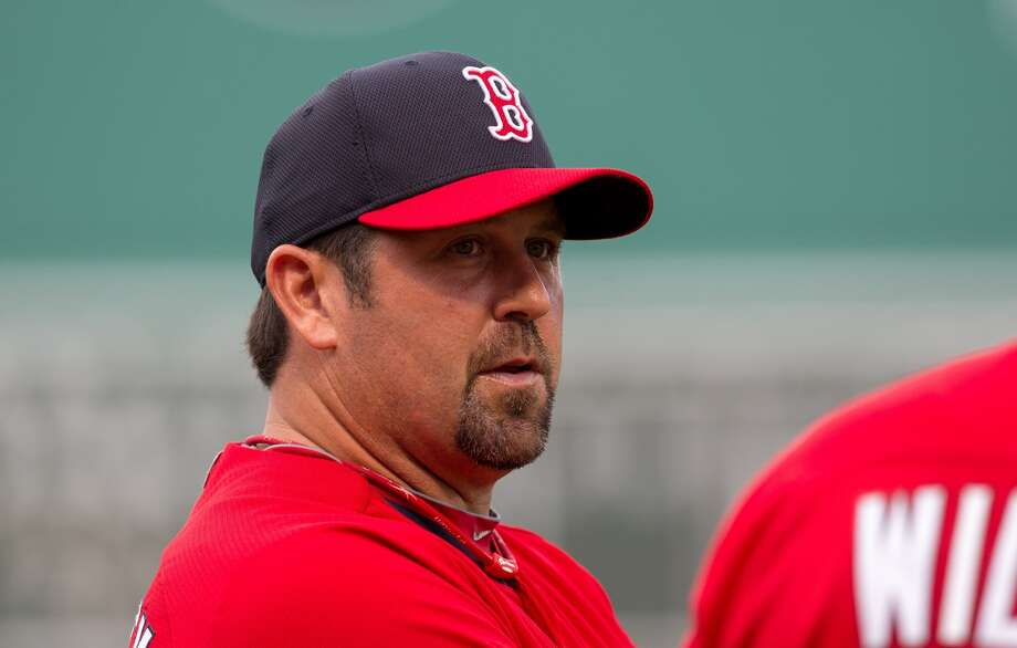 Former Red Sox catcher Jason Varitek talks to a member of the Red Sox coaching staff before a game at Fenway Park between the Boston Red Sox and the Detroit Tigers on July 26, 2015 in Boston, Massachusetts.