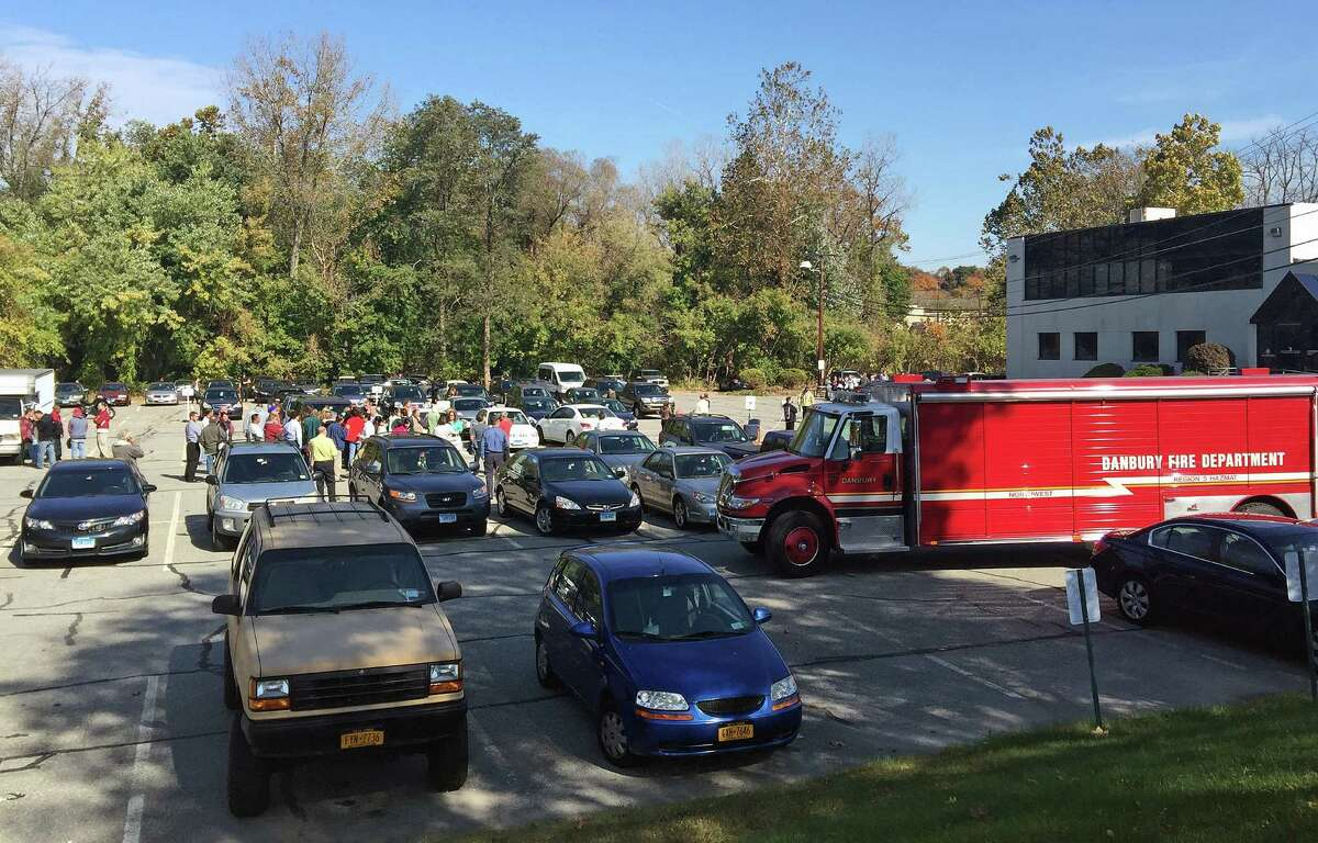 Evacuated employees outside 3 Corporate Drive in Danbury, where a mysterious substance in a vial caused a hazardous material response on Tuesday.