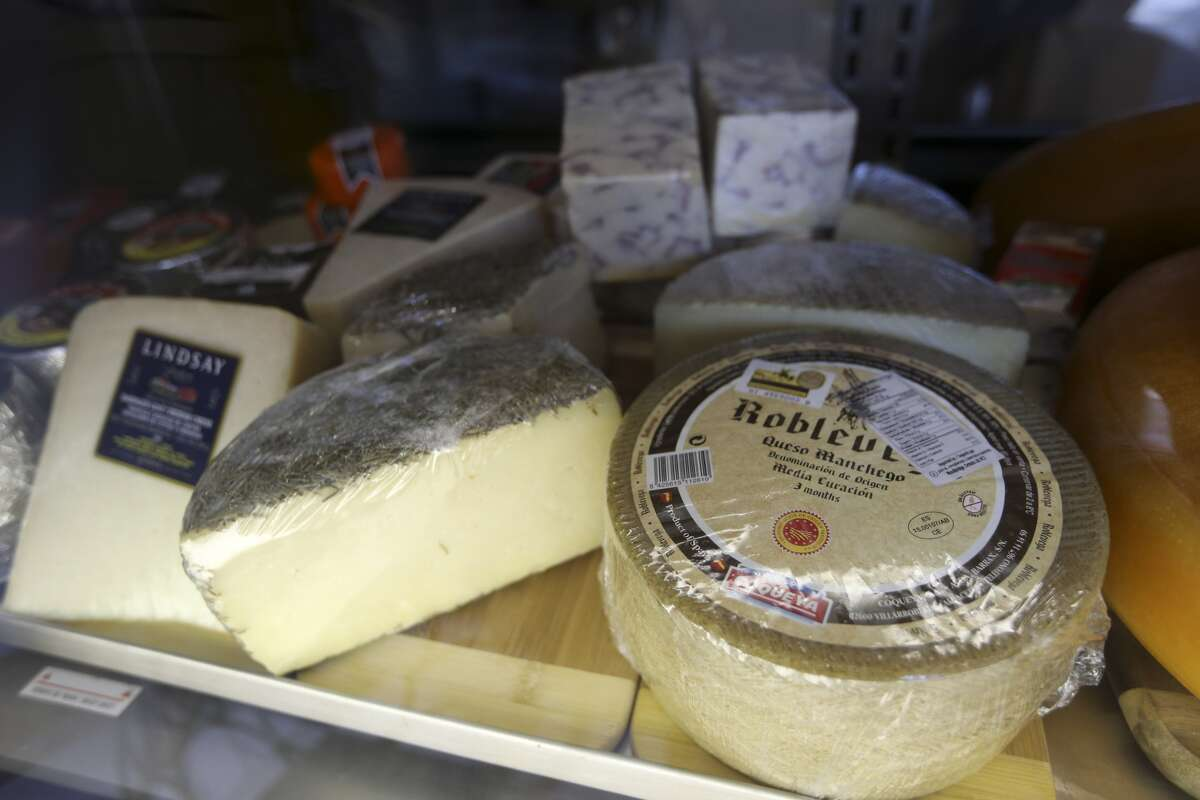 Cheese rounds in the display case.