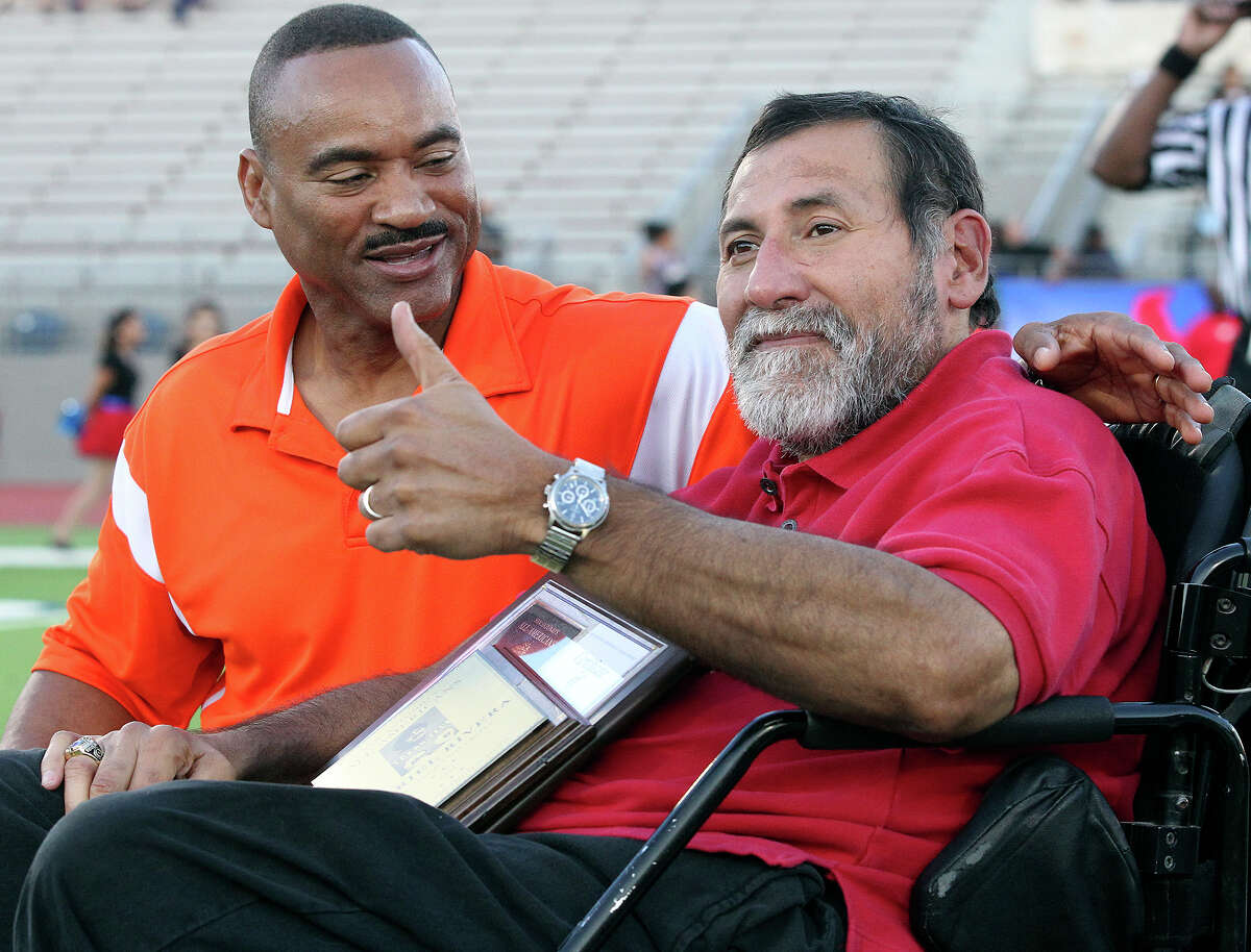 Gary Green and Gabe Rivera (right) get together after being honored in a pregame ceremony as Sam Houston plays Jefferson at Alamo Stadium on Sept. 27, 2014.