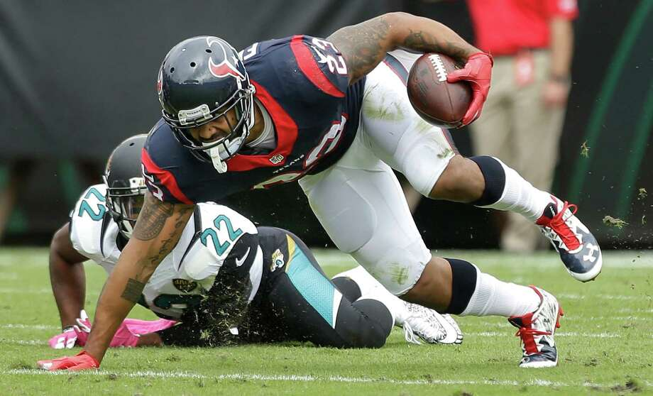 Houston Texans running back Arian Foster (23) puts his hand on the turf running for extra yardage after being hit by Jacksonville Jaguars cornerback Aaron Colvin (22) during the first quarter of an NFL football game at EverBank Field on Sunday, Oct. 18, 2015, in Jacksonville. ( Brett Coomer / Houston Chronicle ) Photo: Brett Coomer, Staff / © 2015  Houston Chronicle