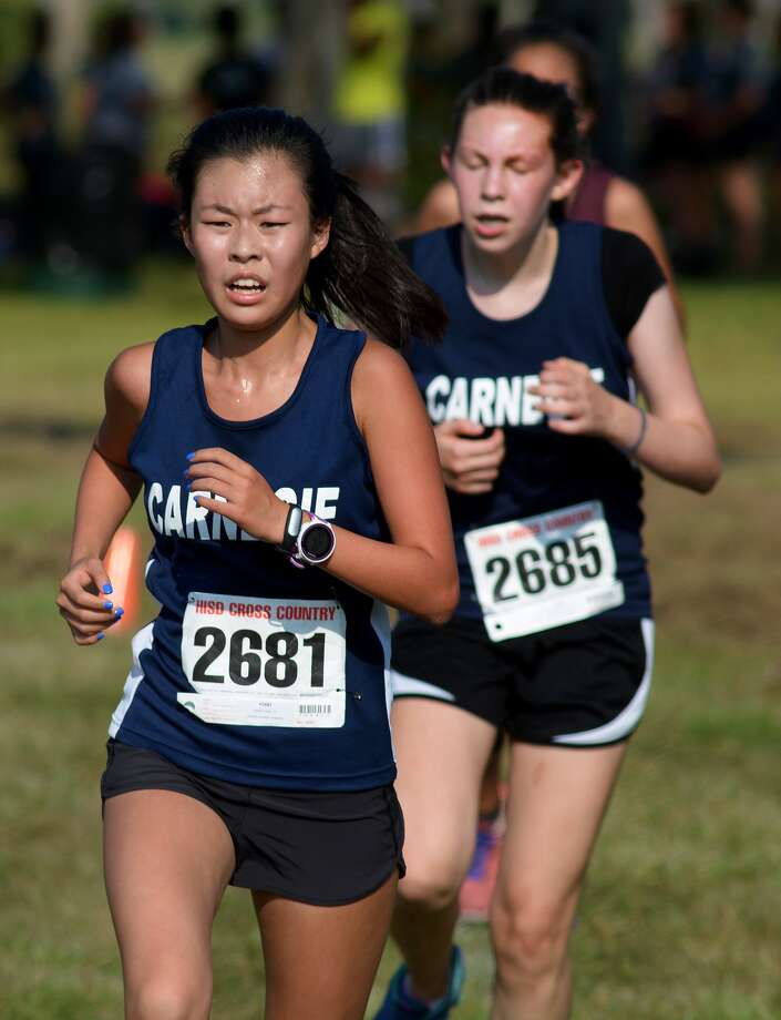 Carnegie Vanguard's senior Kelly Laing (2681) and sophomore Grace Rossmiller (2685) push to the finish line during the District 20-6A Girls Varsity race at the 2015 HISD District Cross Country Meet at Tom Bass Park in Houston on Oct. 12, 2015. (Photo by Jerry Baker/Freelance)4 Photo: Jerry Baker, Freelance