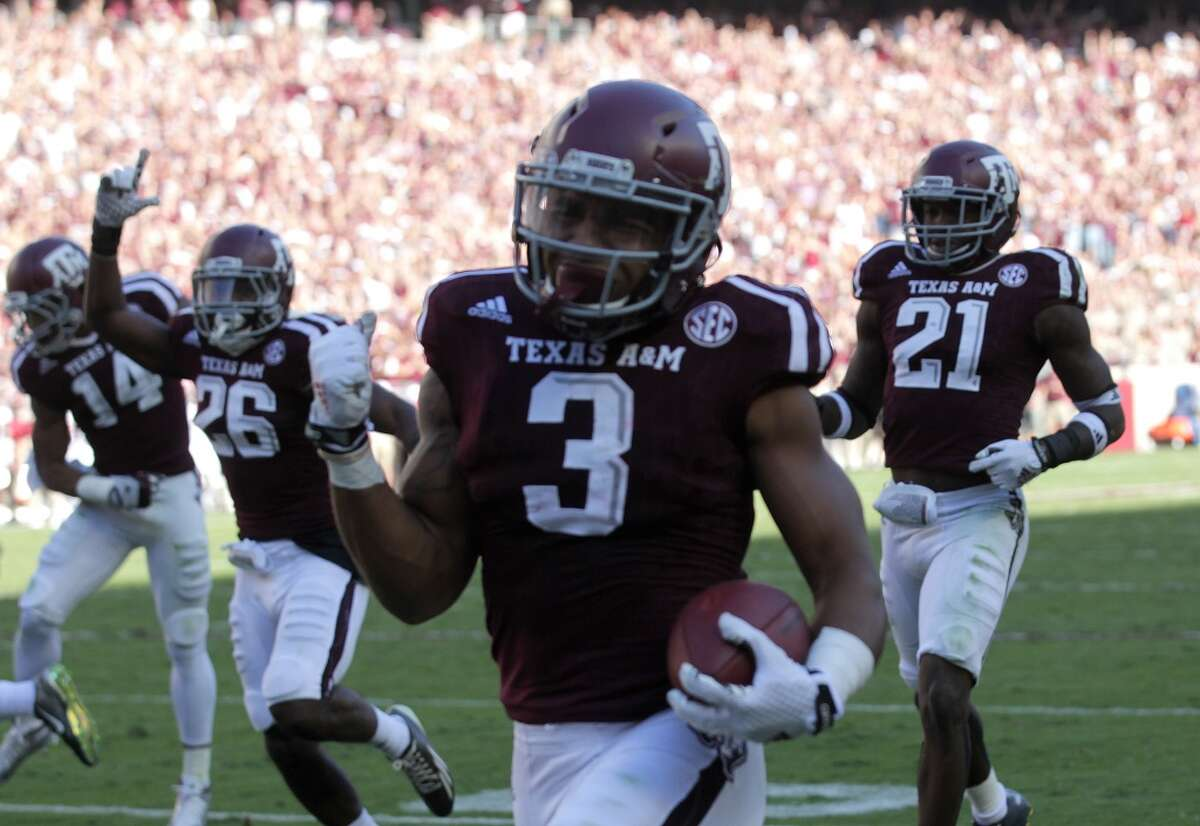 Texas A&M Aggies wide receiver Christian Kirk (3) celebrates as he runs into the end zone for the first touchdown for the Aggies in the second quarter, making the score 28-12. Photos of Texas A&M Aggies football game against Alabama Crimson Tide on Saturday, Oct. 17, 2015, in Houston. ( Elizabeth Conley / Houston Chronicle )