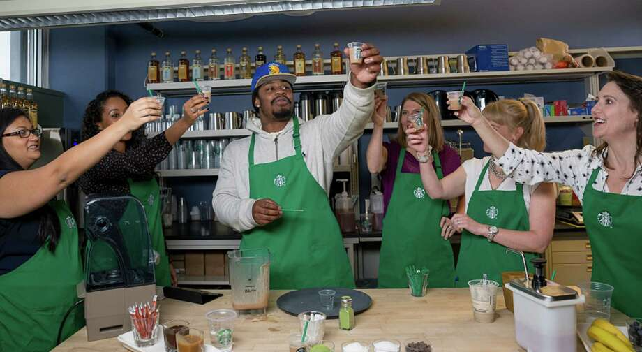 Marshawn Lynch shows off his 'Beast Mode' frappuccino, a collaboration with Starbucks. Photo: Starbucks/Courtesy