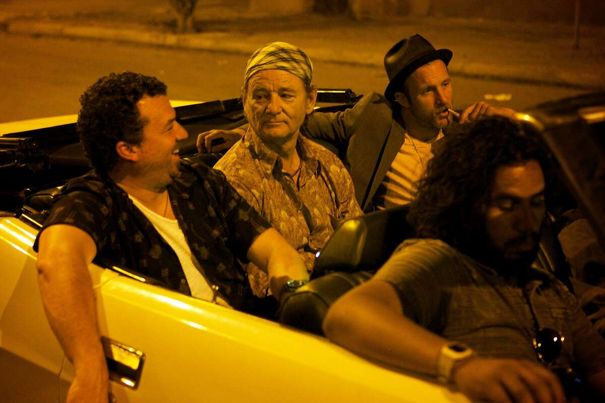 """This photo provided by Open Road Films shows, Danny McBride, from left, as Nick, Bill Murray as Richie Lanz, and Scott Caan as Jake, in """"Rock the Kasbah."""" The movie opens in U.S. theaters Oct. 23, 2015. (Kerry Brown/Open Road Films via AP)"""