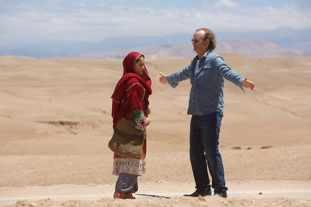 """This photo provided by Open Road Films shows, Leem Lubany, left, as Salima, and Bill Murray as Richie Lanz in """"Rock the Kasbah."""" The movie opens in U.S. theaters Oct. 23, 2015. (Kerry Brown/Open Road Films via AP)"""