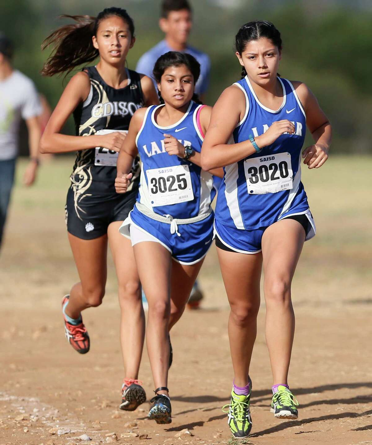 Lanier's JoAnna Benavidez (from right) leads teammate Jovana Espinoza and Edison's Litzy Flores in the varsity girls 3 mile run during the District 28-5A cross country meet at San Antonio State Hospital on Friday, Oct. 16, 2015. Benavidez won the event with a time of 18:59.91. Flores finished second and Espinoza fourth. MARVIN PFEIFFER/ mpfeiffer@express-news.net