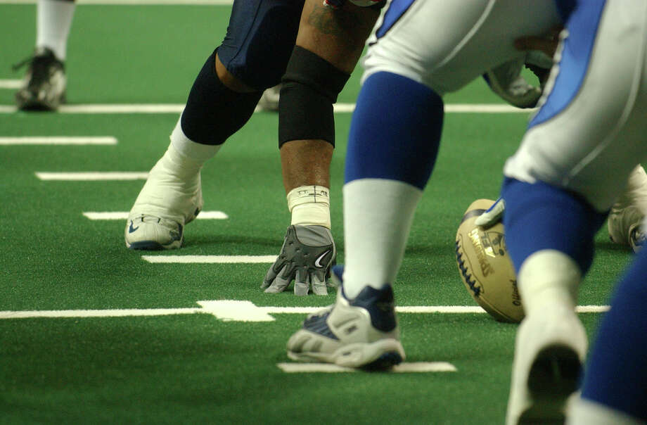 The Austin Wranglers and Dallas Desperados play an Arena Football League game at the Erwin Center in Austin on May 9, 2004. Photo: Express-News File Photo / SAN ANTONIO EXPRESS-NEWS