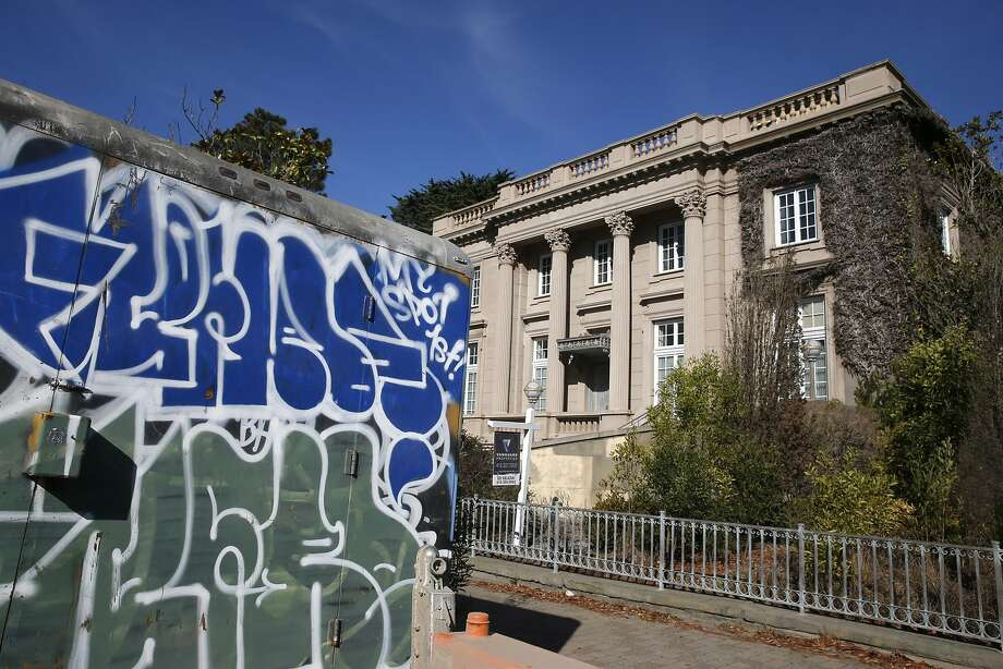 A truck covered with graffiti is parked in front of the Le Petit Trianon mansion on Broadway in Presidio Heights in San Francisco, Calif. on Tuesday, Oct. 20, 2015, after a man was arrested for squatting on the abandoned property and allegedly stealing several pieces of artwork. Photo: Paul Chinn, The Chronicle