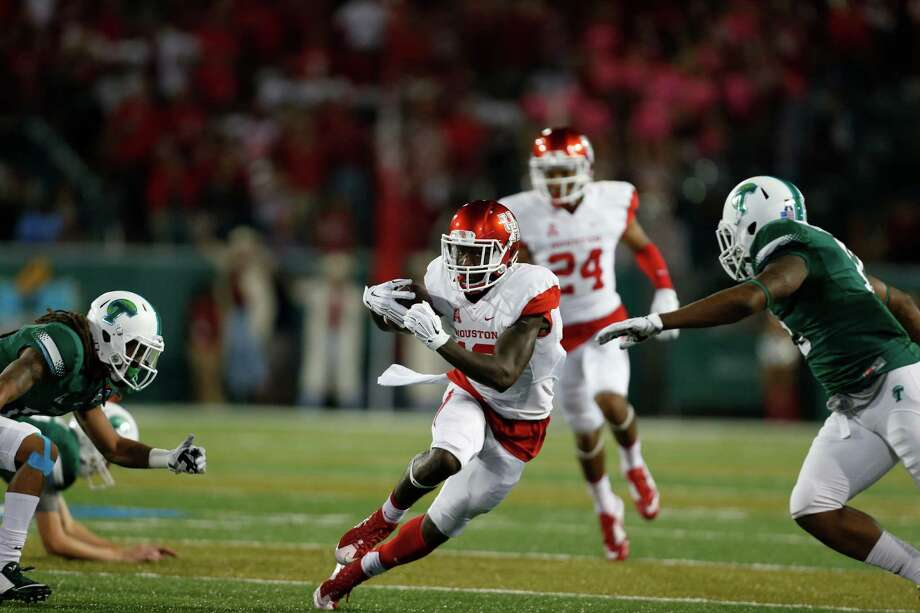 Houston wide receiver Demarcus Ayers (10) dodges Tulane defense during a second half of the NCAA college football game in New Orleans, Friday, Oct. 16, 2015. (AP Photo/Max Becherer) Photo: Max Becherer, FRE / FR 171354AP