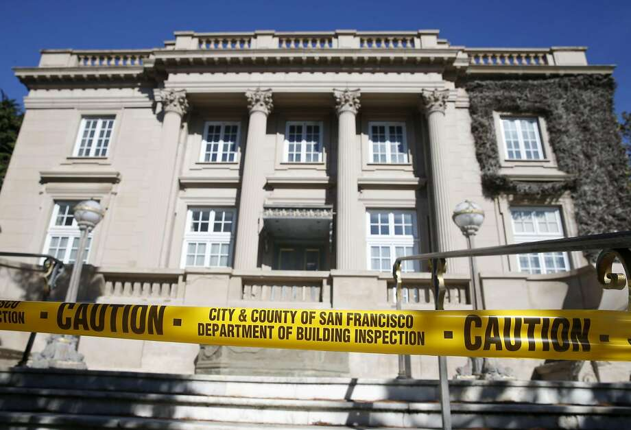 Caution tape blocks the front of the Le Petit Trianon mansion in Presidio Heights in San Francisco, Calif. on Tuesday, Oct. 20, 2015, after a building inspector posted a violation notice. A man was arrested for squatting on the abandoned property and allegedly stealing several pieces of artwork. Photo: Paul Chinn, The Chronicle