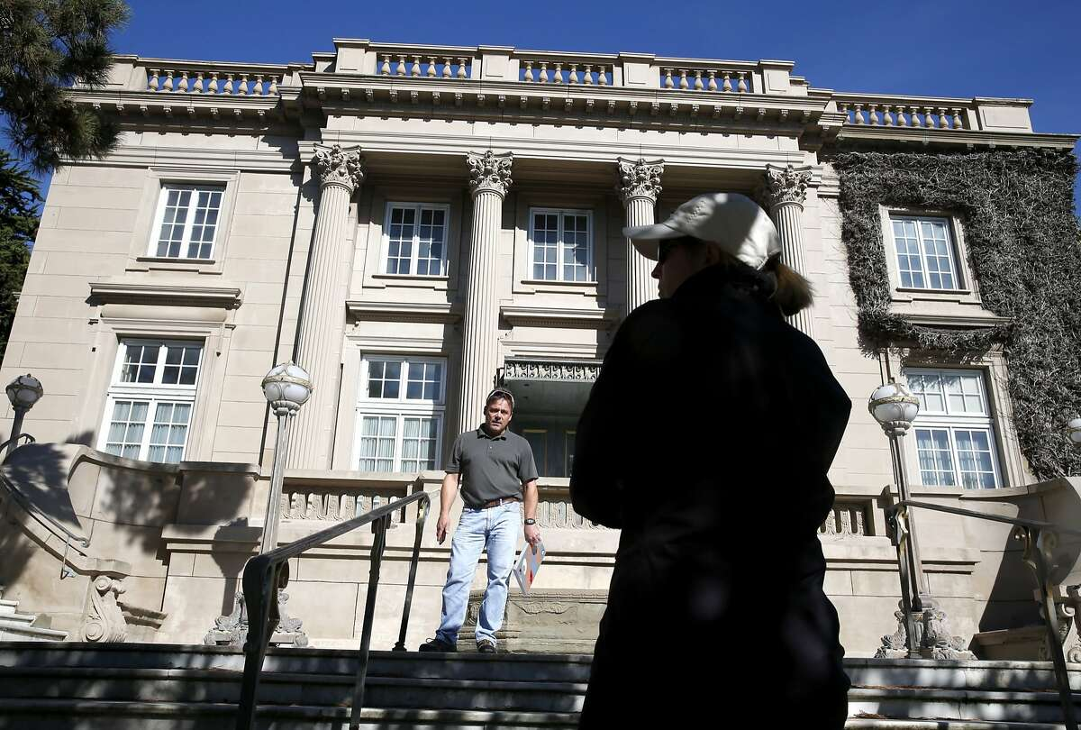 City building inspector Michael Gunnell speaks with Vicki Edwards in San Francisco, Calif. on Tuesday, Oct. 20, 2015, a concerned neighbor who has made several complaints with the city about the abandoned Le Petit Trianon mansion in Presidio Heights. A man was arrested for squatting on the property and allegedly stealing several pieces of artwork.