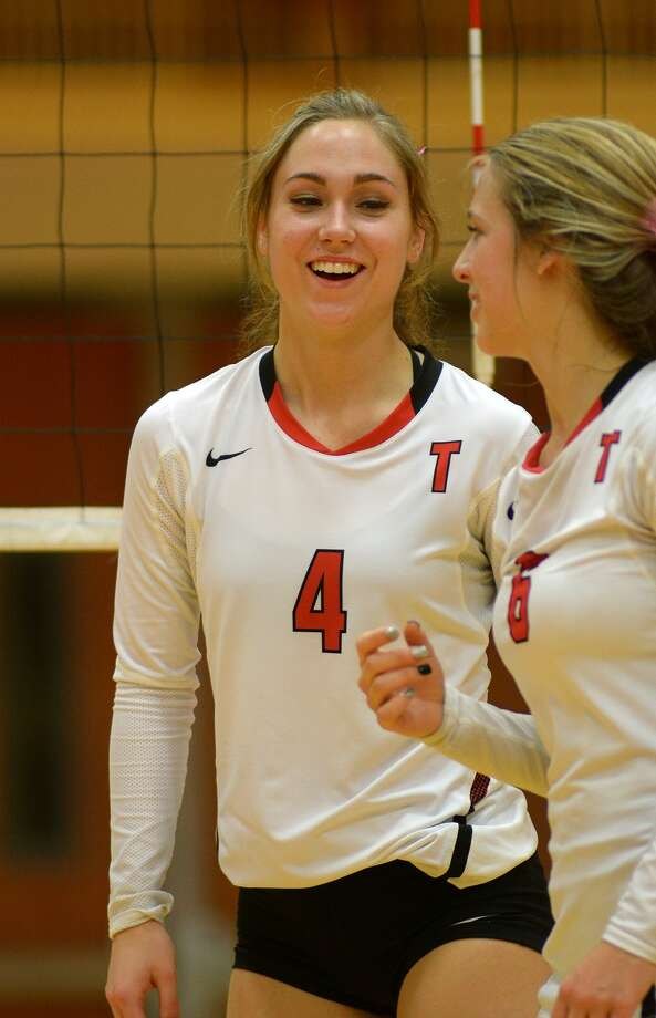Tomball junior outside hitter Faith Allen (4) laughs with teammate Brooke Johnson during their district matchup with Waller. Photo: Jerry Baker, Freelance