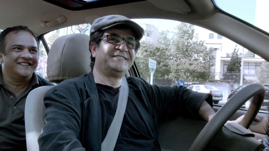 "Iranian director Jafar Panahi, right, takes the wheel in new film ""Taxi."" Photo: HANDOUT, STR / THE WASHINGTON POST"