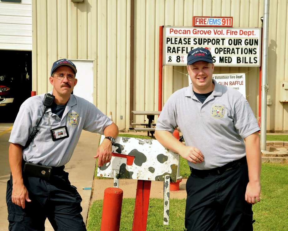 The Pecan Grove Volunteer Fire Department hopes that a ballot proposition for a mandatory fire fee will address a funding crunch caused by dwindling contributions. The department, which includes firefighters Donny Liles, left, and Jesse Grimes, has relied on donations made through utility bills and on fundraisers such as the gun raffle on the station marquee.The Pecan Grove Volunteer Fire Department hopes that a ballot proposition for a mandatory fire fee will address a funding crunch caused by dwindling contributions. The department, which includes firefighters Donny Liles, left, and Jesse Grimes, has relied on donations made through utility bills and on fundraisers such as the gun raffle on the station marquee. Photo: Eddy Matchette, Freelance / Freelance