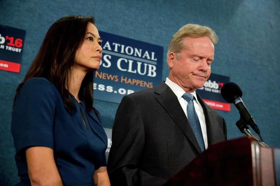 Former Virginia Sen. Jim Webb, accompanied by his wife Hong Le Webb, announced Tuesday he is pulling out of the Democratic race for president during a news conference at the National Press Club in Washington.  Photo: Andrew Harnik, STF / AP