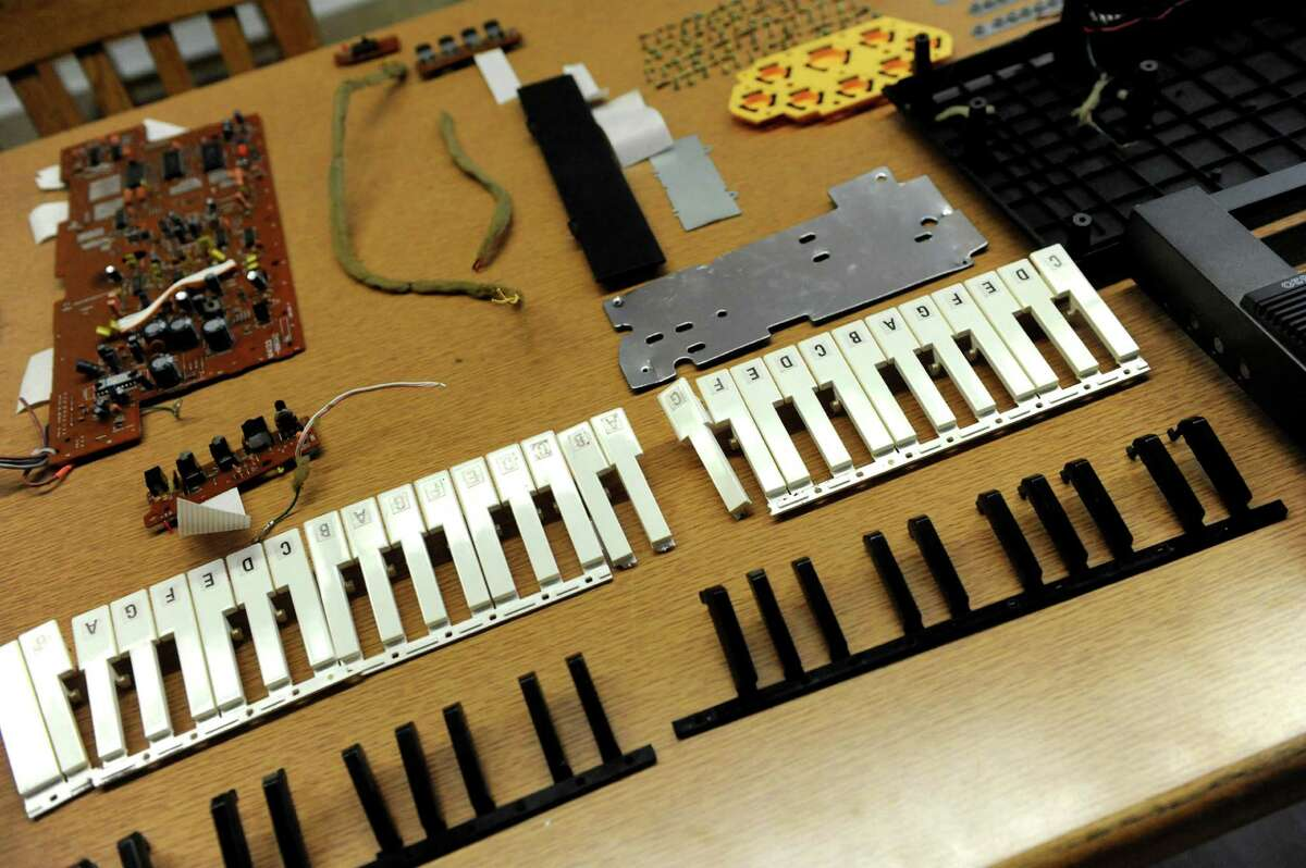 An electronic keyboard is in pieces for students to put back together during the opening celebration of the Susan Odell Taylor School on Tuesday, Oct. 20, 2015, at Russell Sage College campus in Troy, N.Y. (Cindy Schultz / Times Union)
