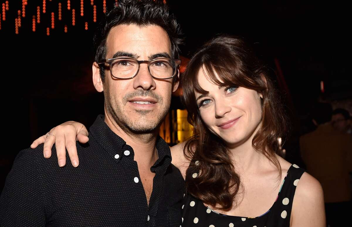 Jacob Pechenik (L) and actress Zooey Deschanel pose at the after party for the premiere of Roadside Attractions' 'The Skeleton Twins' at The Argyle on September 10, 2014 in Los Angeles, California.