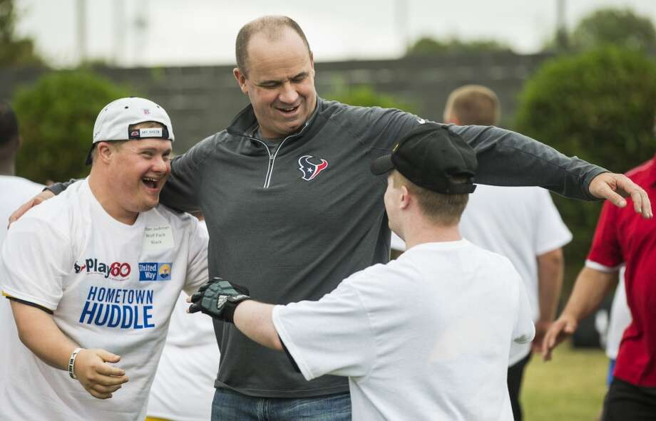 The Houston Texans had a minicamp for Special Olympics athletes during the season. Browse through the rest of these photos for snapshots from the event.Houston Texans head coach Bill O'Brien embraces Jordan Judman, left, and Benjamin Amos during a Houston Texans Hometown Huddle mini camp for Special Olympics athletes on Tuesday, Oct. 20, 2015, in Houston. Texans rookies and head coach Bill O'Brien ran through various football drills with more than 100 Special Olympics athletes, in conjunction with the NFL Play 60 program, at the Houston Texans YMCA. ( Brett Coomer / Houston Chronicle ) Photo: Brett Coomer, Houston Chronicle