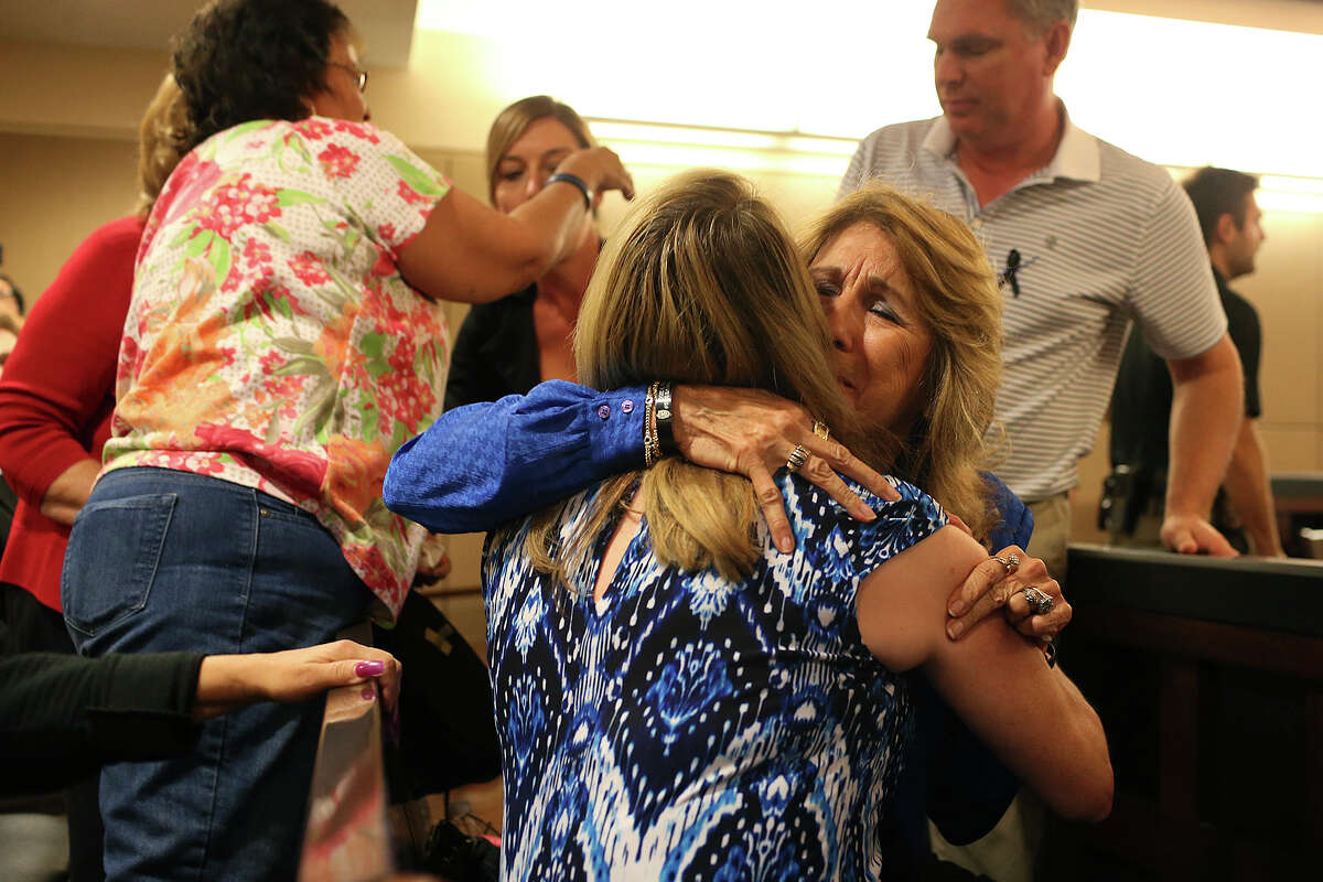 Virginia Jimenez hugs her sister, Bexar County Sheriff's Sgt. Yvonne Vann, back to camera, after a jury returns the death penalty in the capital murder trial of Mark Anthony Gonzalez in the Bexar County 175th State Criminal District Court, Tuesday, Oct. 20, 2015. Gonzalez was convicted in the death of Vanna's husband, Bexar County Sheriff's Sgt. Kenneth Vann in May of 2011.