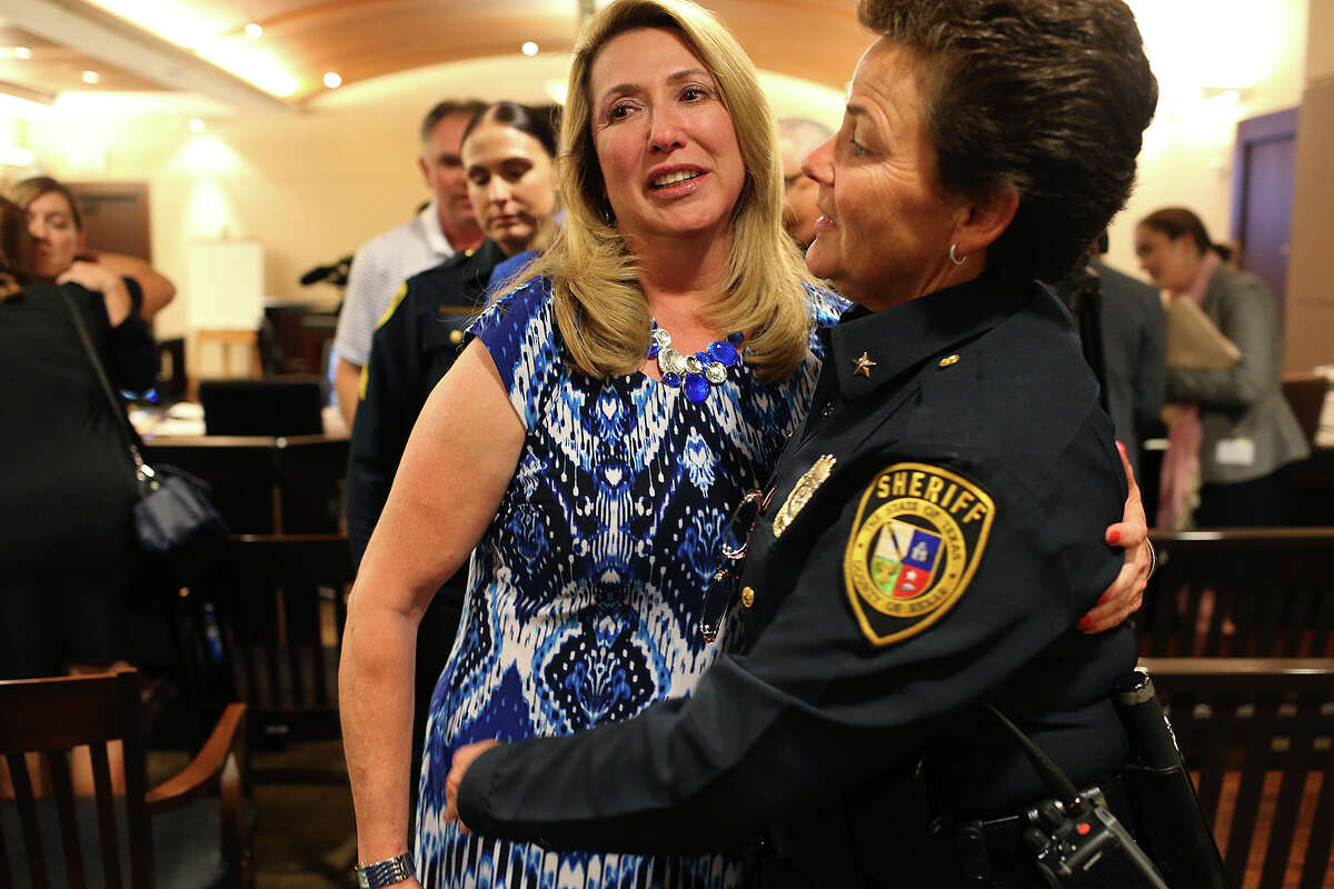 Bexar County Sheriff's Sgt. Yvonne Vann, left, hugs Chief Deputy Tammy Burr after a jury returns the death penalty in the capital murder trial of Mark Anthony Gonzalez in the Bexar County 175th State Criminal District Court, Tuesday, Oct. 20, 2015. Gonzalez was convicted in the death of her husband, Bexar County Sheriff's Sgt. Kenneth Vann in May of 2011.