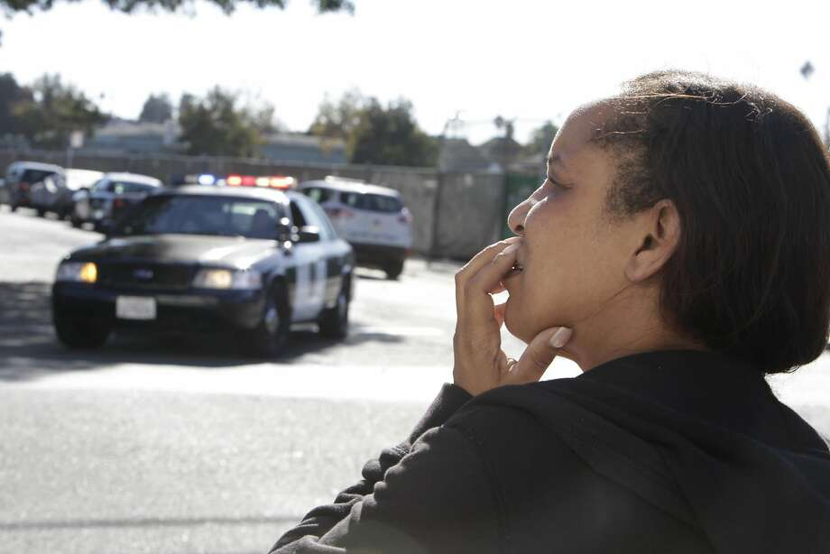 Annette Miller looks down a street in her neighborhood after seeing police investigating an incident  on Tuesday, October 21,  2015 in Oakland, Calif. Photo: Lea Suzuki, The Chronicle