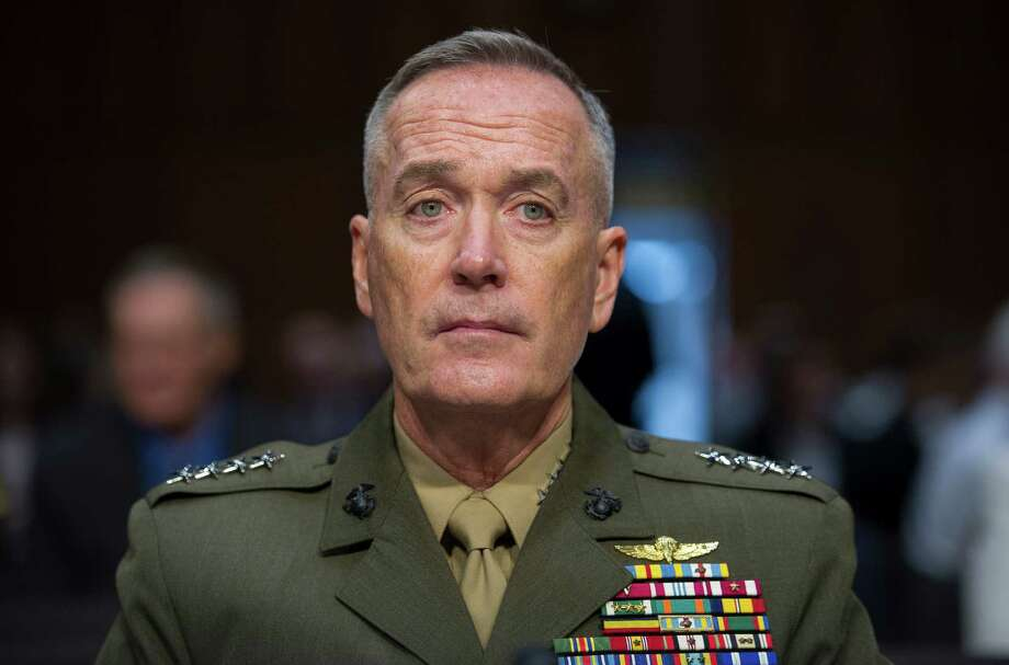 FILE - In this July 9, 2015, file photo, Marine Corps Commandant Gen. Joseph Dunford, Jr., testifies during his Senate Armed Services Committee confirmation hearing to become the Chairman of the Joint Chiefs of Staff, on Capitol Hill in Washington. The top U.S. military officer landed in Iraq Tuesday, Oct. 20, 2015, to get an update on the battle against Islamic State militants, saying he sees no prospect right now for Russia to expand its airstrike campaign into the war-torn country.(AP Photo/Cliff Owen, File) Photo: Cliff Owen, FRE / FR170079 AP