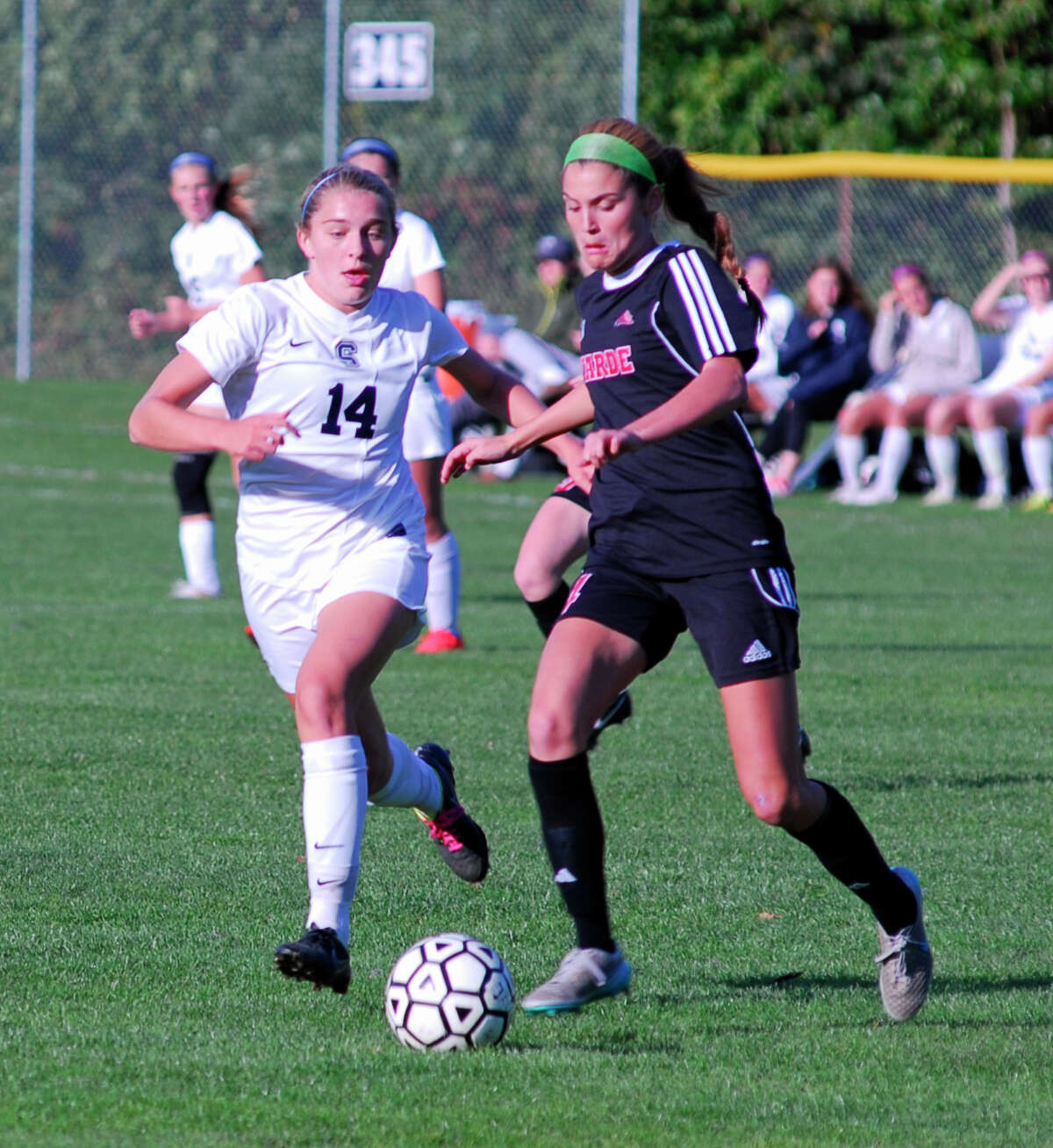 Staples' Lydia Shaw, left, and Warde's Claire Pullen battle during a girls soccer game on Tuesday, October 20th, 2015 in Westport, Connecticut. Warde won 2-1.