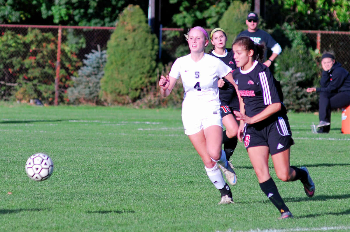 Staples Brynly Marsh, left, and Warde's Jennifer Maldonado chase after a loose ball during a girls soccer game between Staples and Warde on Tuesday, October 20th, 2015 in Westport, Connecticut. Staples lost 2-1.