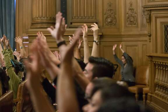 Members of the audience show their approval during remarks made about San Francisco's current sanctuary policies at the regular meeting of the board at City Hall on Tuesday, Oct. 20, 2015 in San Francisco, Calif.