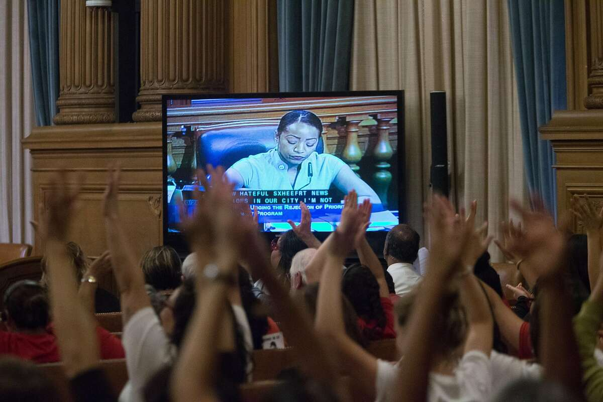 Members of the audience show their approval during supervisor Malia Cohen's remarks about San Francisco's current sanctuary policies at the regular meeting of the board at City Hall on Tuesday, Oct. 20, 2015 in San Francisco, Calif.