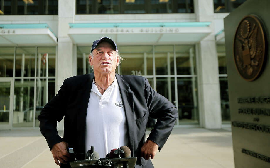 "Former Minnesota Gov. Jesse Ventura talks to reporters at the Warren E. Burger Federal Building and United States Courthouse after a defamation hearing, Tuesday, Oct. 20, 2015, in St. Paul, Minn.  An attorney for the estate of slain ""American Sniper"" author Chris Kyle has asked a federal appeals court to overturn a $1.8 million defamation judgment for Ventura. Ventura accused Kyle of making up a story in his book about punching Ventura at a bar in 2006 after Ventura supposedly made offensive remarks about Navy SEALs.  (Elizabeth Flores /Star Tribune via AP)  MANDATORY CREDIT; ST. PAUL PIONEER PRESS OUT; MAGS OUT; TWIN CITIES LOCAL TELEVISION OUT Photo: Elizabeth Flores, MBO / Star Tribune"