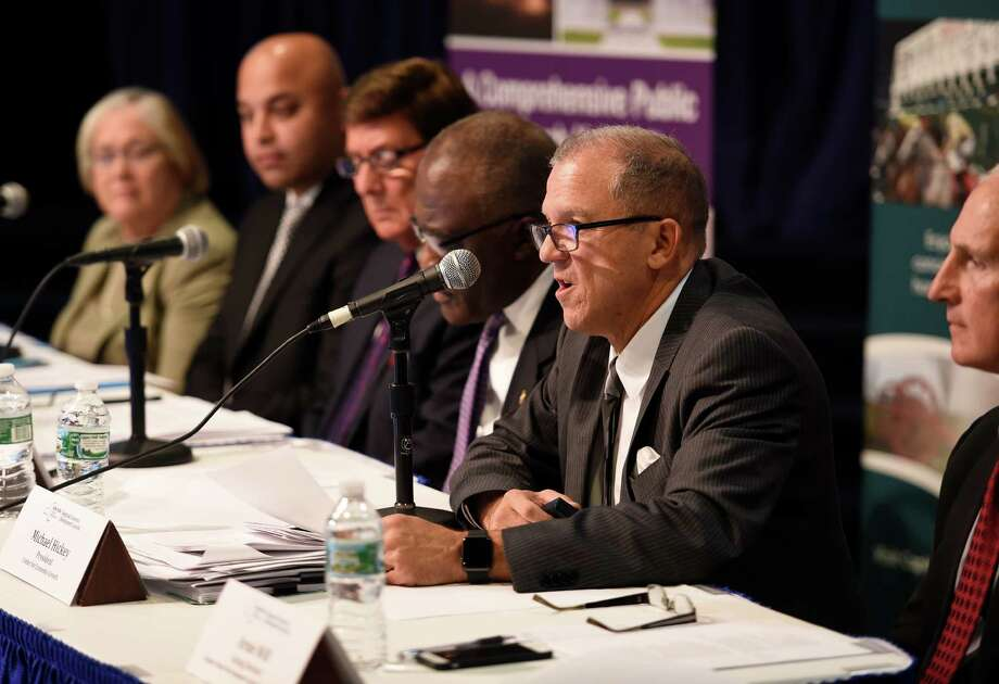 Mike Hickey of the Center for Economic Growth gives his presentation for the Capital Region Regional Economic Development Council during hearings with the Governor's panel for regional development funding Tuesday morning Oct. 20, 2015,  in Albany, N.Y. Hickey is now CEO of Monolith Solar. (Skip Dickstein/Times Union) Photo: SKIP DICKSTEIN / 10033838A