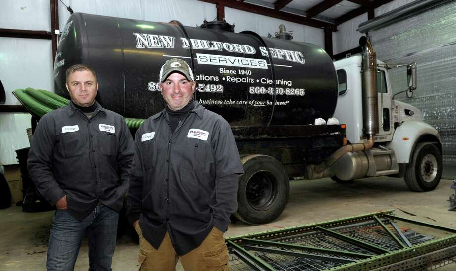 George, left, and Chris Sam are co-owners of New Milford Septic, which is celebrating 75 years in business. Photo: Carol Kaliff / Hearst Connecticut Media / The News-Times
