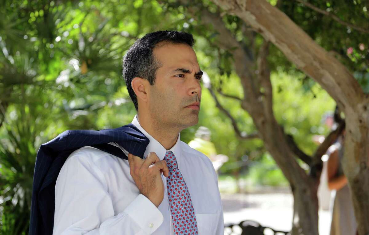 Texas Land Commissioner George P. Bush tours the grounds of the Alamo following a news conference to celebrate the $31.5 million the General Land Office received for the preservation and development of the Alamo, Wednesday, Sept. 2, 2015, in San Antonio. (AP Photo/Eric Gay)
