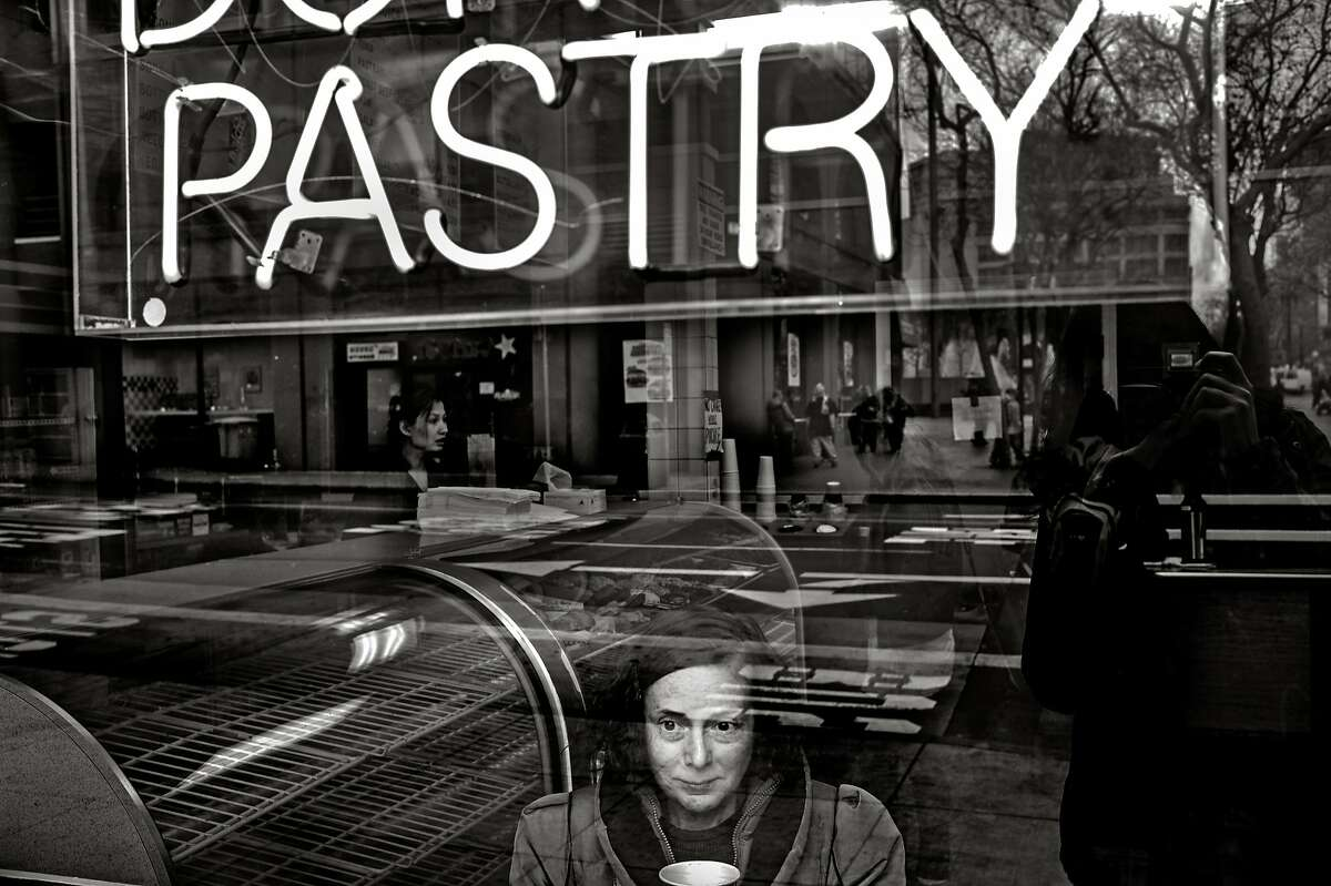 Photographer Darcy Padilla approached the woman with the blank stare while working in San Francisco's mid-Market corridor. When Padilla asked her name, the woman answered, �