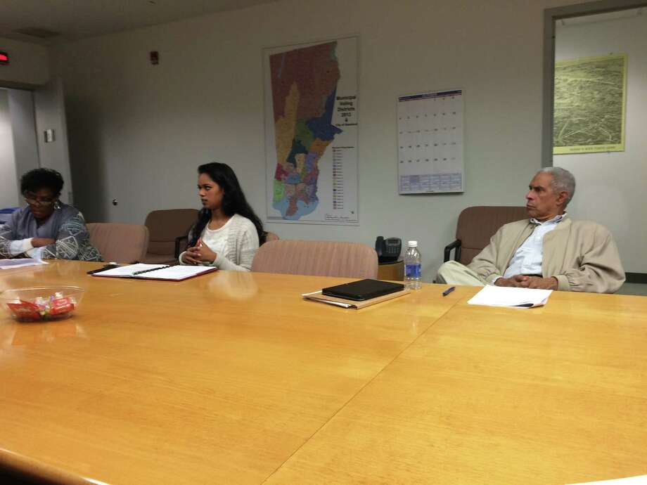 UConn-Stamford Student Government Association President Shahanara Shahjahan, center, tells the Education Committee of the Board of Representatives on Tuesday how the university's new common schedule would affect commuting students, as city Reps. Lila Wallace, left, and Virgil de la Cruz, right, listen. Photo: Alex Gecan /The Advocate