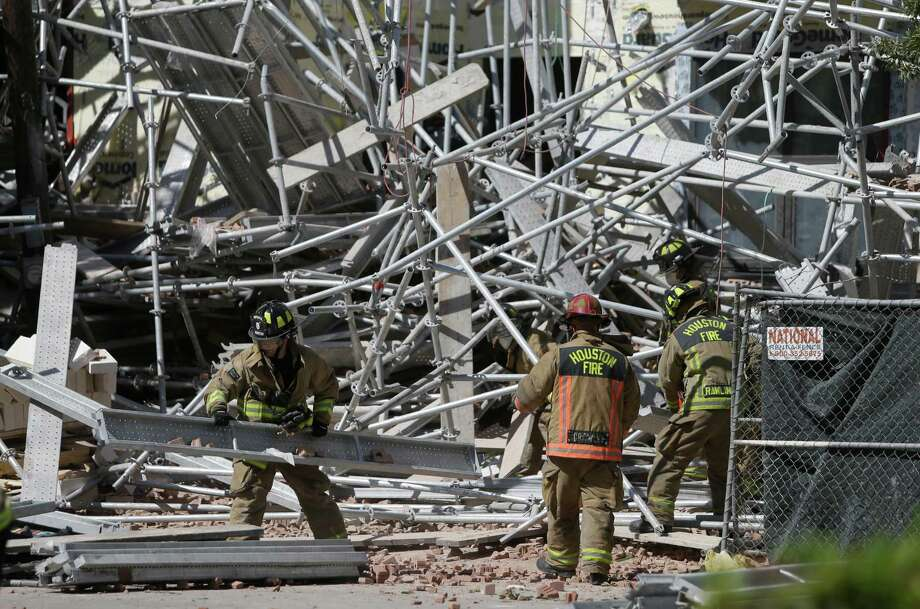 Six people were injured in the recent scaffolding collapse at a building under construction on Crawford near Congress. A restraining order forbids firms from tampering with any evidence. Photo: Melissa Phillip, Staff / © 2015 Houston Chronicle