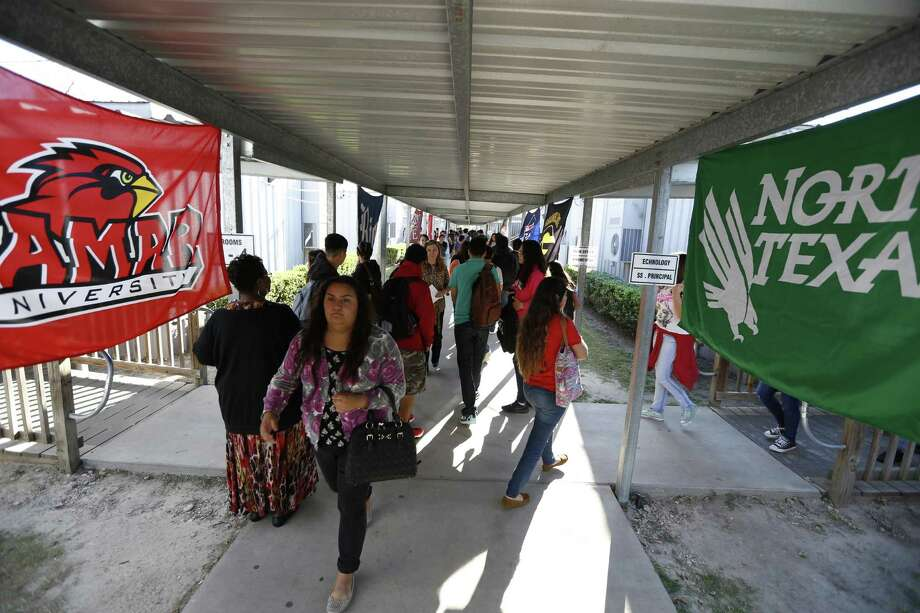 North Houston Early College High School students are motivated by flags of universities where past students have gone on to attend. Photo: Steve Gonzales, Staff / © 2015 Houston Chronicle